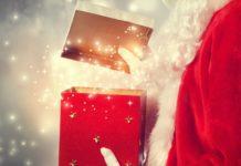 Santa Claus holding a present